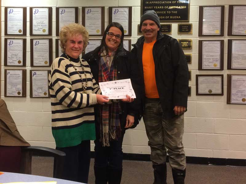 Council President Rosalie M. Baker presents our 2015 Holiday Lighting Contest First Place Winner with a certificate and prize.